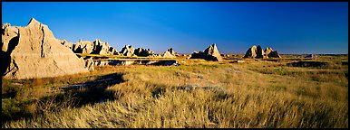 Badlands raising in tall grass prairie landscape, Cedar Pass. Badlands National Park (Panoramic color)