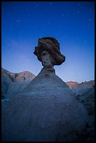 Pedestal rock at badlands at night. Badlands National Park, South Dakota, USA.