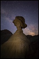 Balanced rock at night with starry sky and Milky Way. Badlands National Park, South Dakota, USA.
