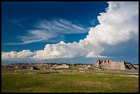 Afternoon clouds above buttes and prairie, South Unit. Badlands National Park, South Dakota, USA. (color)