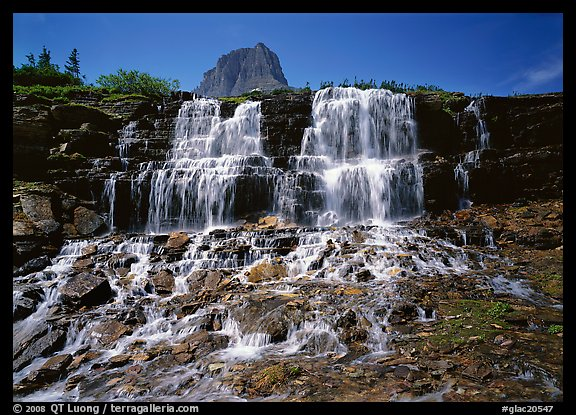 Waterfall at hanging gardens, with top of Mountain. Glacier National Park (color)