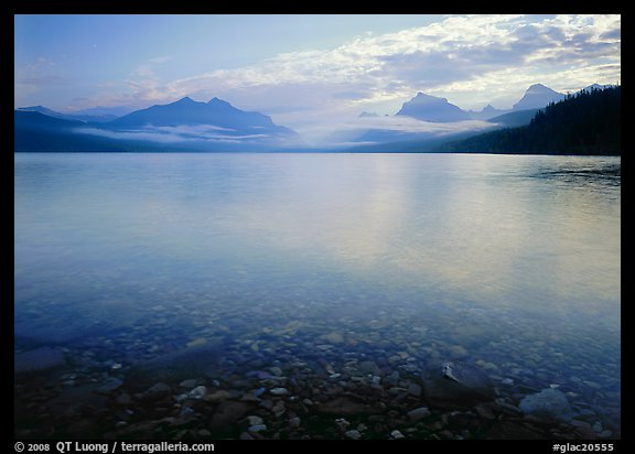 Lake McDonald with clouds and mountains reflected in early morning. Glacier National Park (color)
