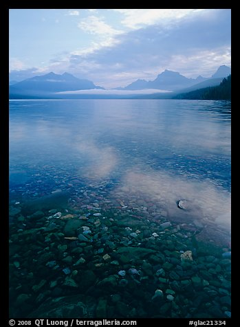 Pebbles, lake Mc Donald, and foggy mountain range, early morning. Glacier National Park (color)