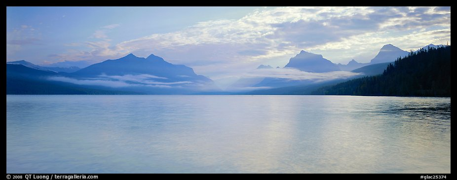 Serene lake with clouds hanging over mountains. Glacier National Park (color)