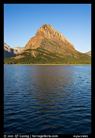 Grinnell Point across Swiftcurrent Lake, sunrise. Glacier National Park (color)
