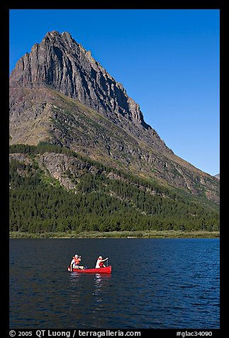 Red canoe on Swiftcurrent Lake. Glacier National Park (color)