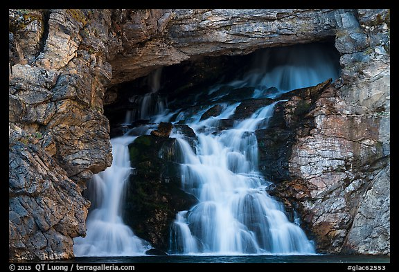 Water flows of opening in cliff face, Running Eagle Falls. Glacier National Park (color)