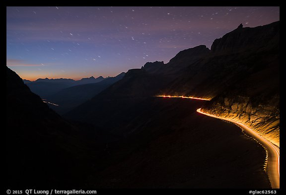 Going-to-the-Sun road at dusk with car lights. Glacier National Park, Montana, USA.