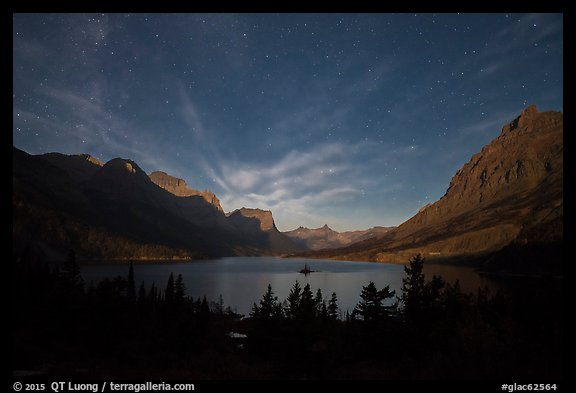 Saint Mary Lake at night with light from rising moon. Glacier National Park, Montana, USA.
