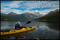 Kayaker paddles away from shore, Kintla Lake. Glacier National Park ( color)