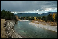 Dark clouds over North Fork of Flathead River in autumn. Glacier National Park ( color)