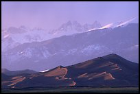 Distant view of the dune field and Sangre de Christo mountains at sunset. Great Sand Dunes National Park and Preserve, Colorado, USA.