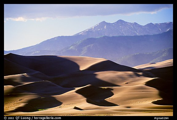 Distant view of dunes and Sangre de Christo mountains in late afternoon. Great Sand Dunes National Park and Preserve (color)