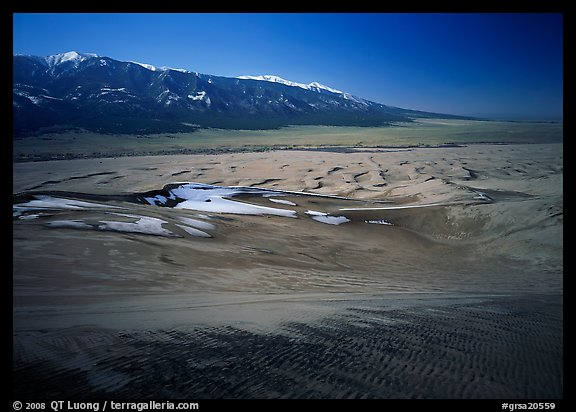 Sand dunes with patches of snow seen from above. Great Sand Dunes National Park and Preserve (color)
