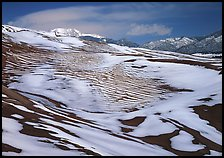 Melting snow on the dunes. Great Sand Dunes National Park and Preserve, Colorado, USA.