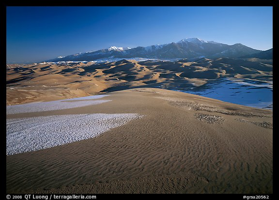 Sand dunes with snow patches and Sangre de Christo range. Great Sand Dunes National Park and Preserve (color)