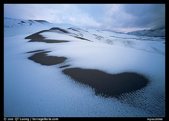 Patch of sand in snow-covered dunes. Great Sand Dunes National Park (color)
