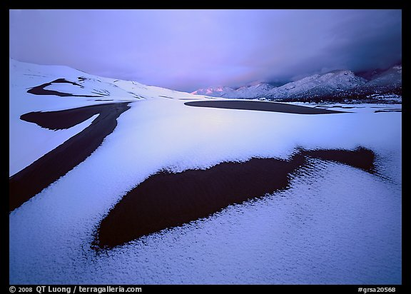 Patch of sand in snow-covered dunes at dawn. Great Sand Dunes National Park (color)
