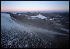 Sparse snow on the dunes at dawn. Great Sand Dunes National Park and Preserve, Colorado, USA.