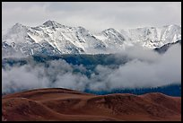 Snowy Sangre de Cristo Mountains and clouds above dune field. Great Sand Dunes National Park, Colorado, USA. (color)
