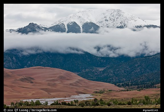 Dunes and Medano creek below snowy mountains. Great Sand Dunes National Park and Preserve (color)