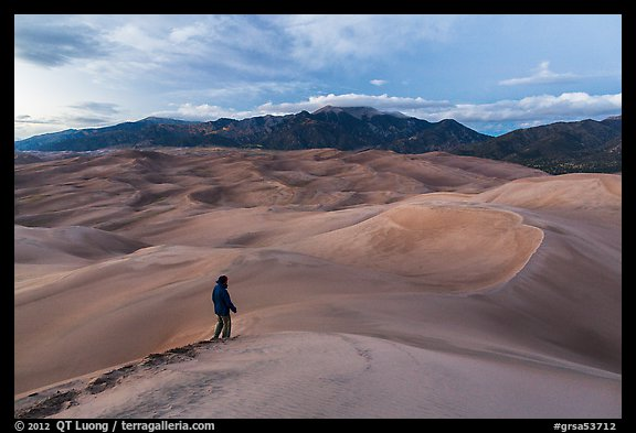 Visitor looking, dune field. Great Sand Dunes National Park and Preserve (color)