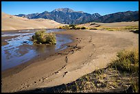 Banks of flowing Medano Creek, dunes and mountains. Great Sand Dunes National Park and Preserve ( color)