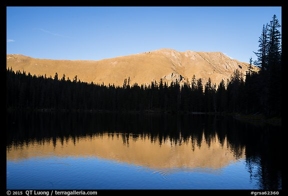 Mountain reflection and line of trees, Sand Creek Lake. Great Sand Dunes National Park and Preserve (color)