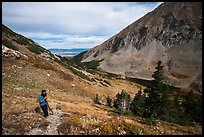 Hiker above Medano Lakes. Great Sand Dunes National Park and Preserve ( color)