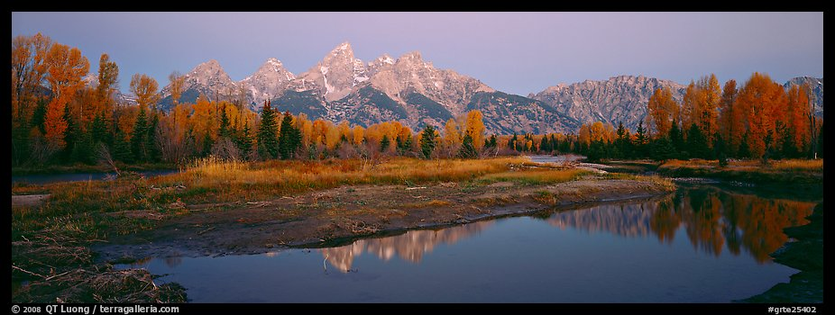 Jagged mountains and autumn colors reflected at sunrise. Grand Teton National Park (color)