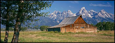 Rustic barn and Grand Teton range. Grand Teton National Park (Panoramic color)
