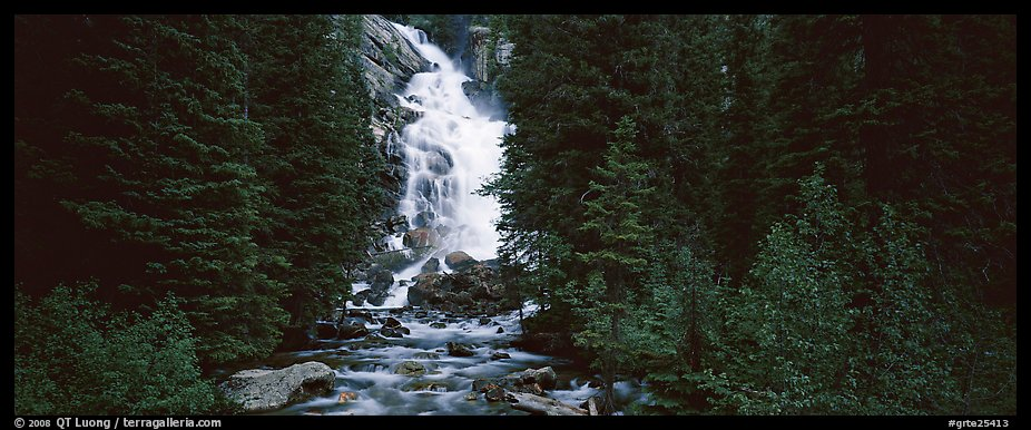 Waterfall flowing in dark forest. Grand Teton National Park (color)