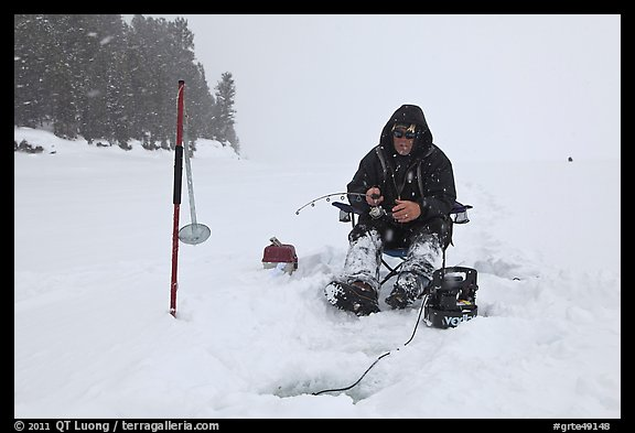 Ice fisherman in white-out, Jackson Lake. Grand Teton National Park (color)