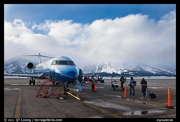Passengers boarding aircraft, Jackson Hole Airport, winter. Grand Teton National Park (color)