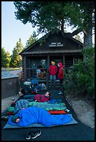 Outdoorsmen camping out in front of Jenny Lake Ranger Station for permits. Grand Teton National Park ( color)