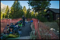 Hikers and climbers camped out in front of Jenny Lake Ranger Station for permits. Grand Teton National Park ( color)
