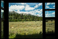 Tetons seen from inside Laurence S. Rockefeller Preserve visitor center. Grand Teton National Park ( color)