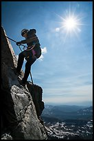 Woman climber rappelling on Grand Teton. Grand Teton National Park ( color)