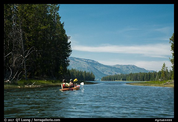 Kayakers approach narrow channel, Colter Bay. Grand Teton National Park (color)