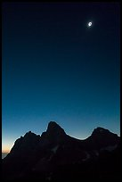 Solar eclipse above the Tetons, diamong ring. Grand Teton National Park, Wyoming, USA.
