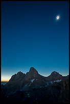 Tetons with eclipsed sun. Grand Teton National Park, Wyoming, USA.