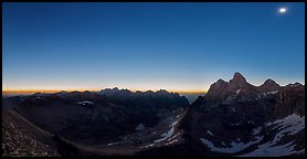 Omnidirectional horizon glow and eclipsed sun over the Tetons. Grand Teton National Park (Panoramic color)