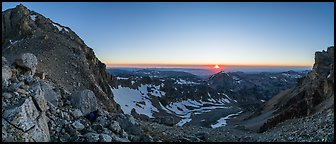 View from from Lower Saddle with Middle Teton and sun setting. Grand Teton National Park (Panoramic color)