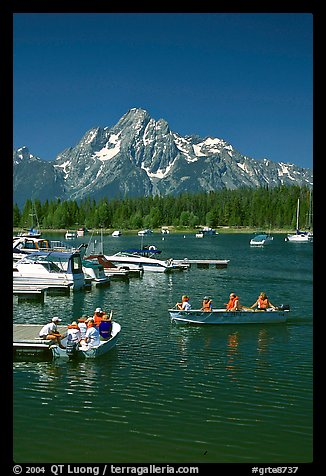 Boaters at Colter Bay marina with Mt Moran in the background, morning. Grand Teton National Park (color)
