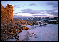 Rock tower and neve at sunset, Toll Memorial. Rocky Mountain National Park, Colorado, USA.