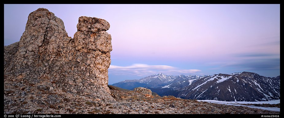 Rock towers on high pass and mountains at dusk. Rocky Mountain National Park (color)