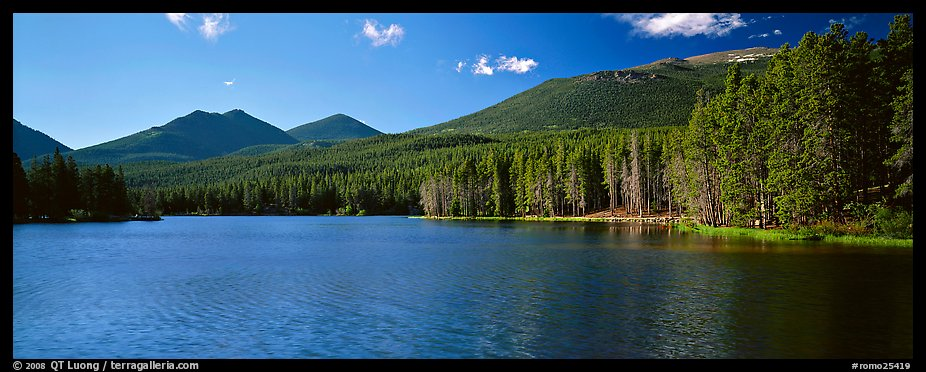 Clear lake with forested shores. Rocky Mountain National Park (color)