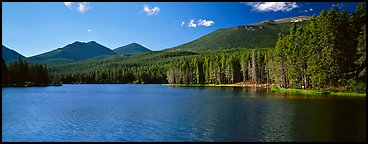 Clear lake with forested shores. Rocky Mountain National Park, Colorado, USA.