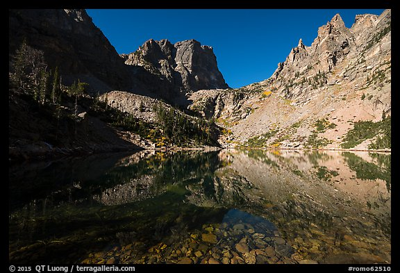 Granite walls climb straight out of Emerald Lake. Rocky Mountain National Park (color)