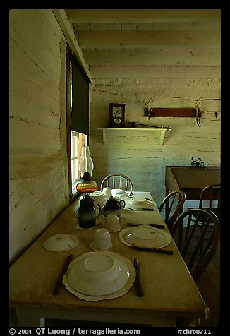 Dining table inside Roosevelt's Maltese Cross Cabin. Theodore Roosevelt National Park (color)